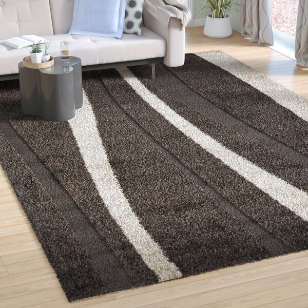 Mika Brown Area Rug by Wade Logan