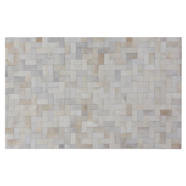 Natural Hide Hand-Tufted Cowhide Ivory Area Rug by Exquisite Rugs