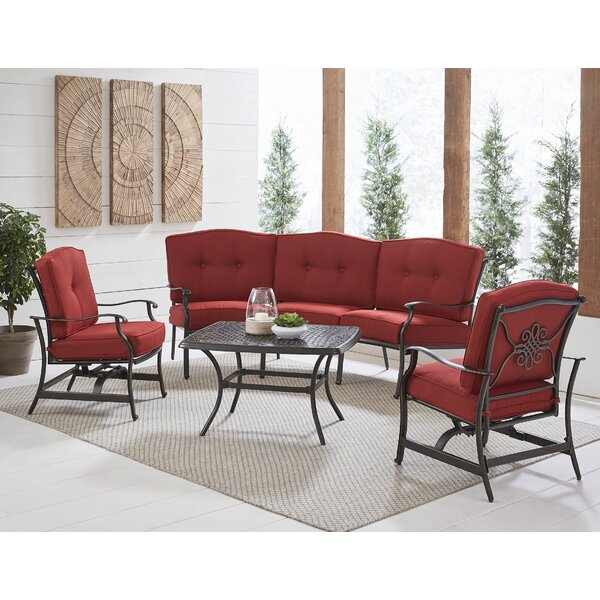 Carleton 4-Piece Patio Set with Cast-Top Coffee Table, Crescent Sofa and 2 Cushioned Rockers in Blue by Fleur De Lis Living