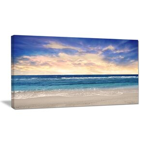 Clear Blue Sky and Ocean at Sunset Photographic Print on Wrapped Canvas by Design Art