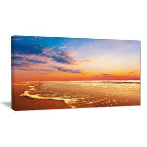 Fascinating Beach with Flowing Waves Photographic Print on Wrapped Canvas by Design Art