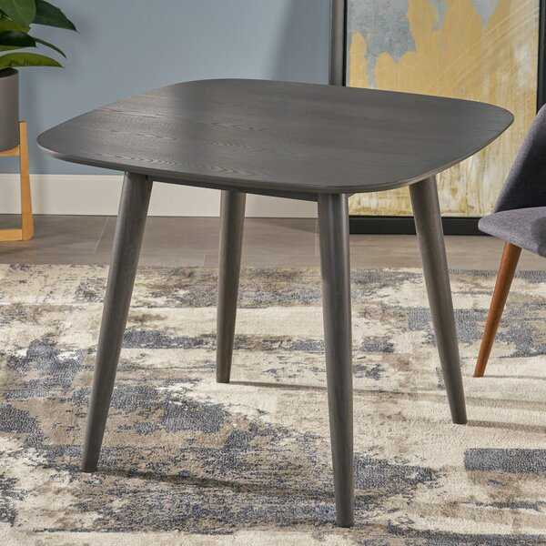 Pekalongan Mid Century Modern Faux Wood Dining Table by Ebern Designs