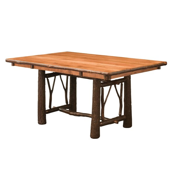 Quinney Twig Trestle Solid Wood Dining Table by Loon Peak