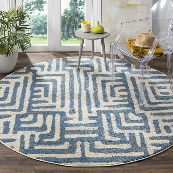Vadim Ivory/Light Blue Area Rug by World Menagerie