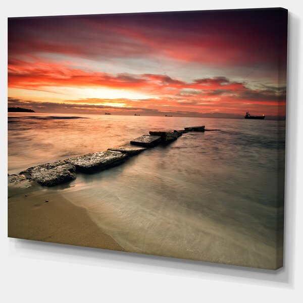 Wonderful Sunrise on Black Ocean Photographic Print on Wrapped Canvas by Design Art