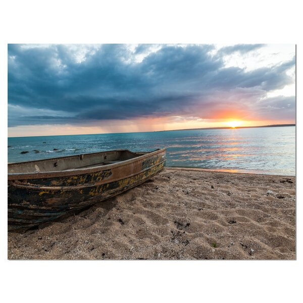 Rusty Row Boat on Sand at Sunset Photographic Print on Wrapped Canvas by Design Art
