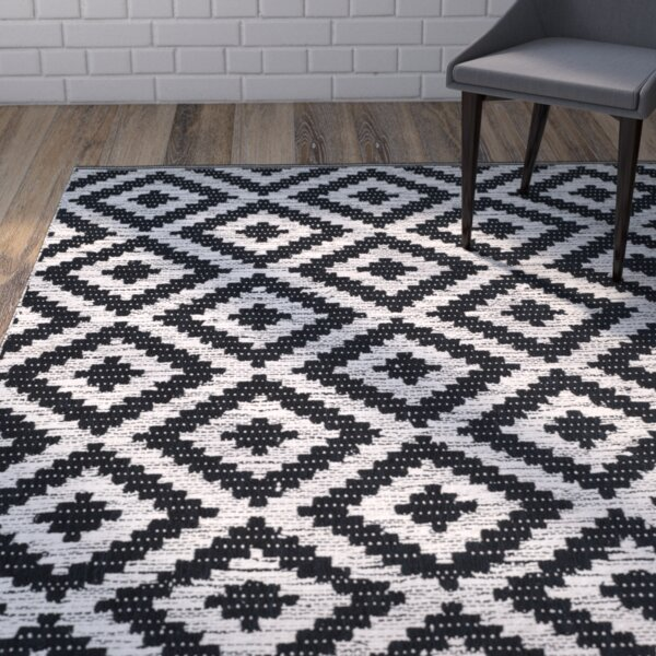 Harlow Hand-Woven Black/Ivory Area Rug by Wrought Studio