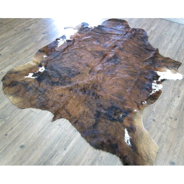 Walpole Hand-Woven Cowhide Brindle Brown Area Rug by Loon Peak