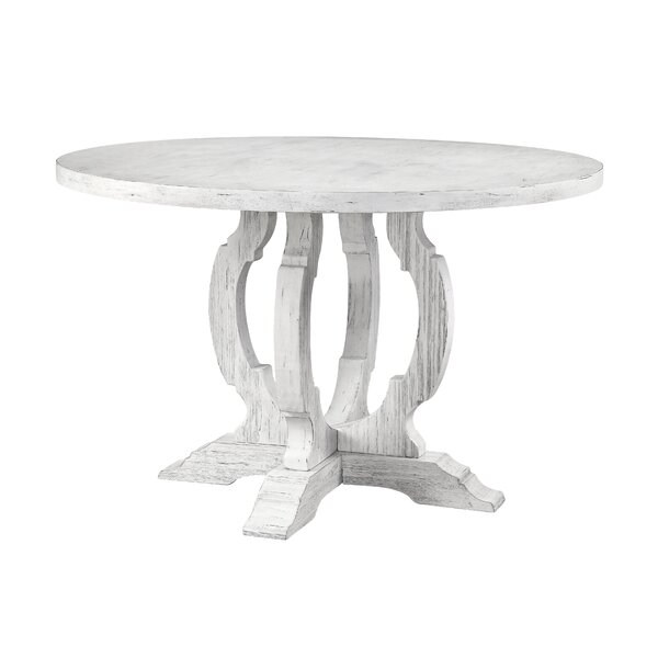 Caigan Solid Wood Dining Table by Ophelia & Co.