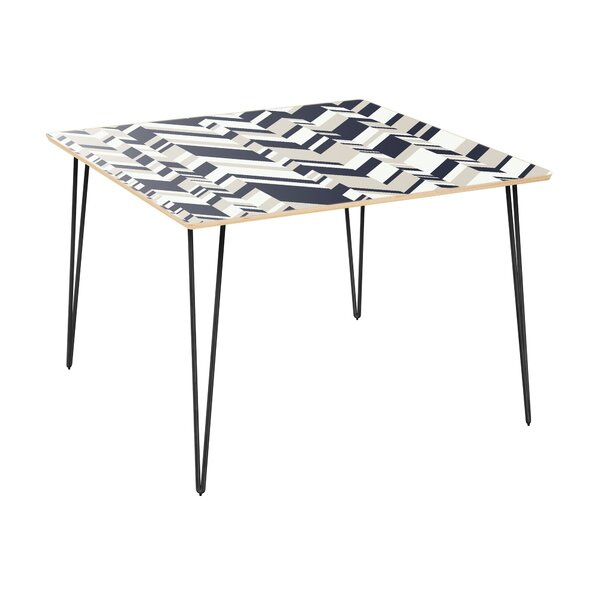 Gaige Dining Table by Orren Ellis