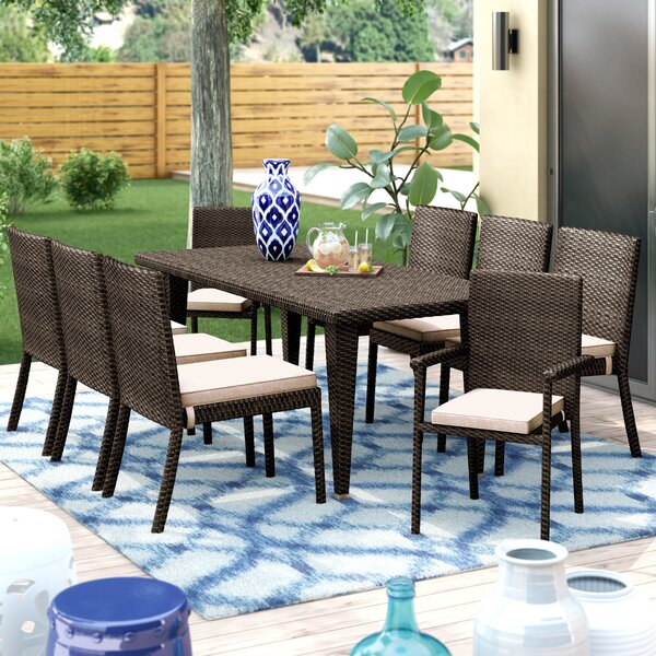 Renea Outdoor 9 Piece Dining Set with Cushions by Ivy Bronx