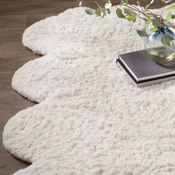 Bigby Hand-Tufted Faux Sheepskin Natural Area Rug by Mercury Row