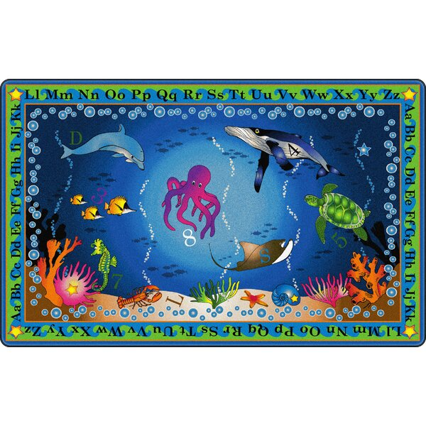 Into The Deep Blue Area Rug by Flagship Carpets