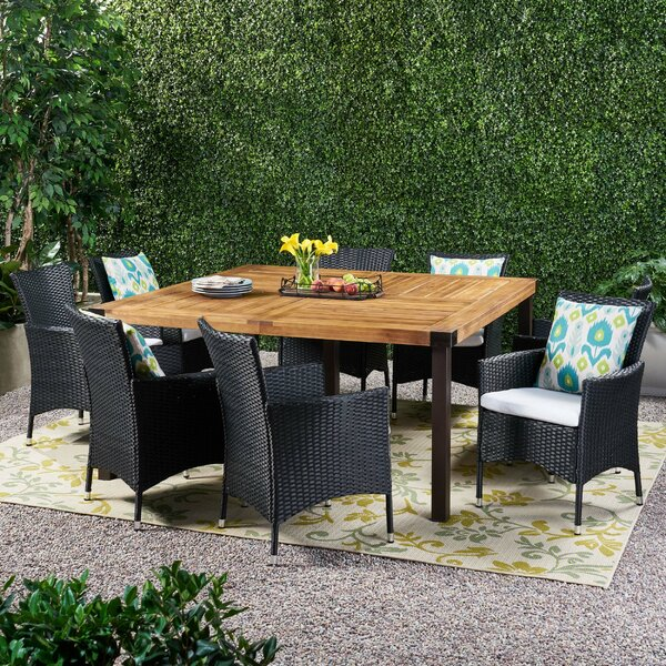 Labelle Outdoor 9 Piece Dining Set with Cushions by Ivy Bronx