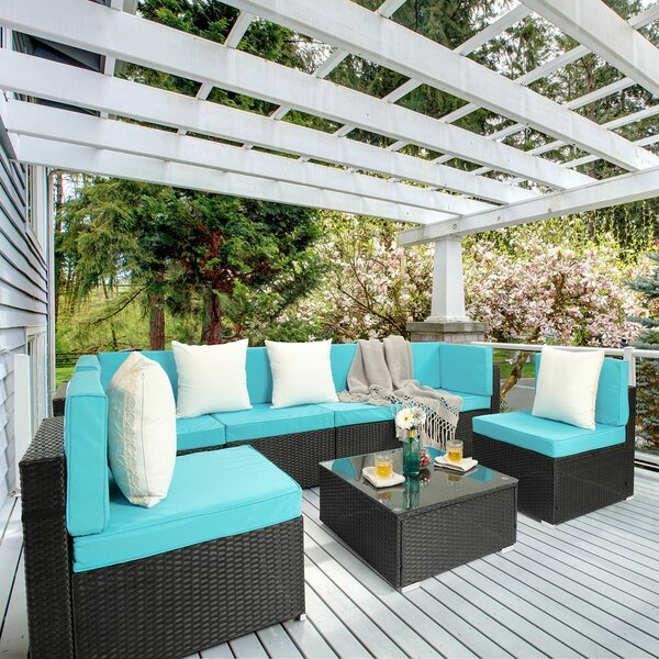 Arwynn 7 Piece Rattan Sectional Seating Group with Cushions