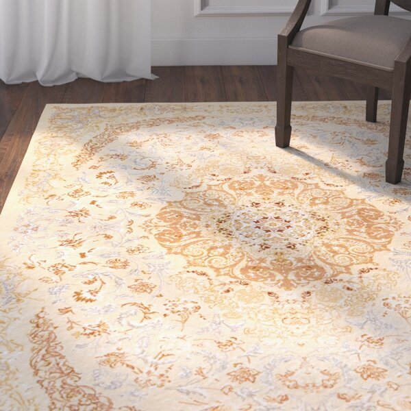 Krittika Ivory Area Rug by Astoria Grand