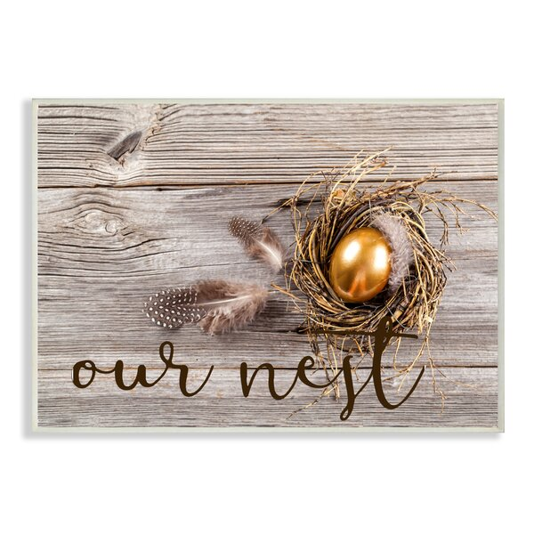 Our Nest Golden Egg Distressed Graphic Art Print by Stupell Industries