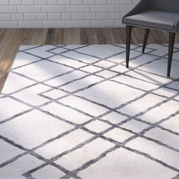 Colligan Diamond Dogs Ivory Area Rug by Brayden Studio