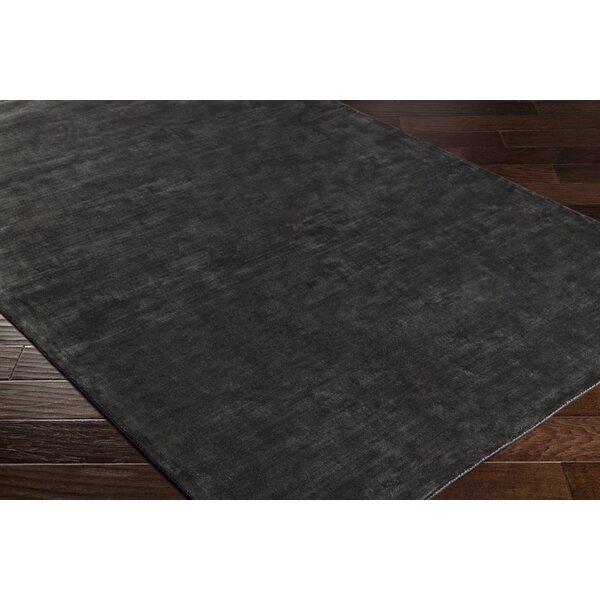Ayala Hand-Loomed Black Area Rug by Orren Ellis