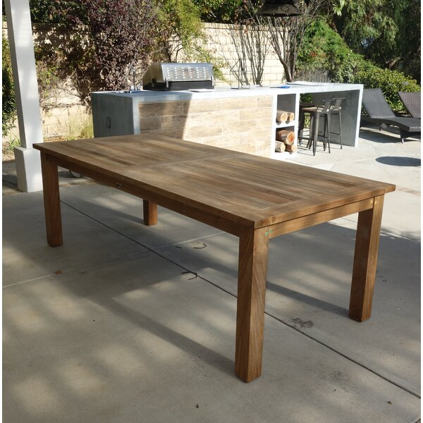 Khalid Solid Wood Dining Table by Bay Isle Home