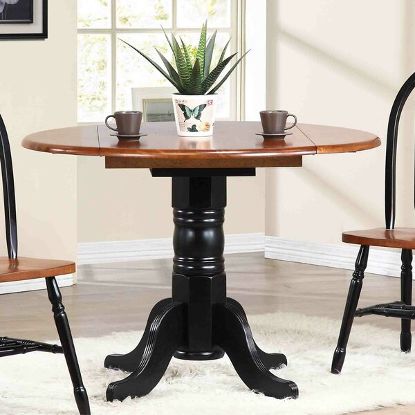 Irie Extendable Solid Wood Dining Table by Loon Peak