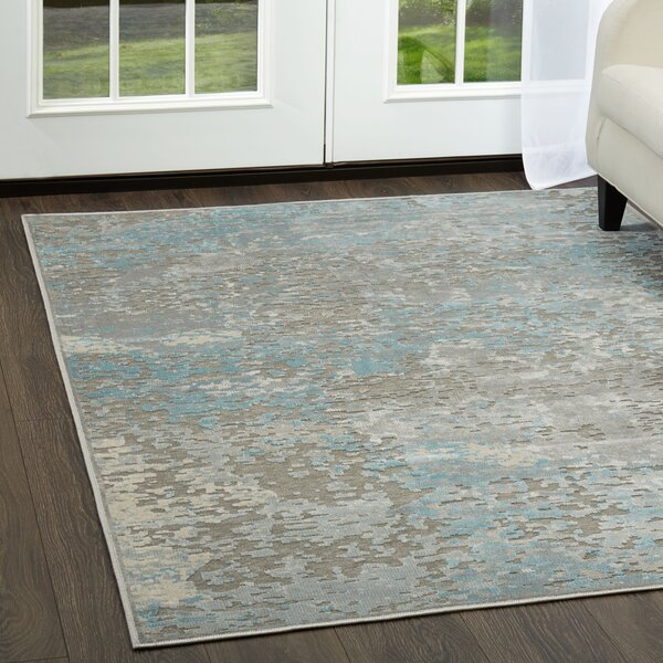 Infinity Gray/Blue Area Rug by Nicole Miller
