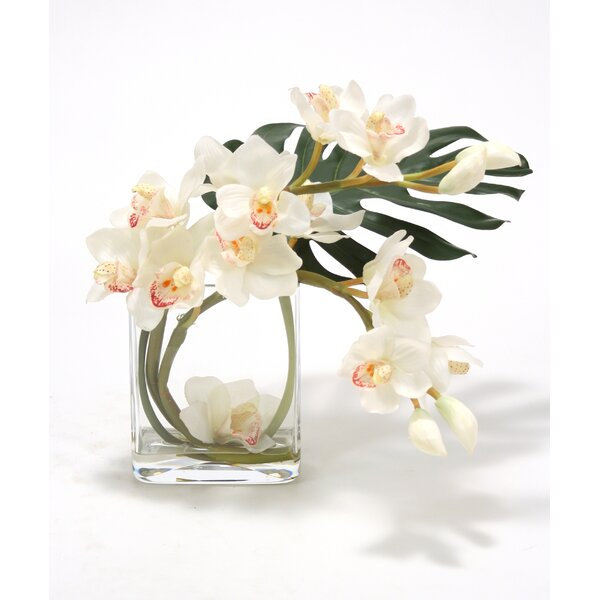 Waterlook Orchid Silk with Split Philodendron Leaf in Curved Rectangular Clear Glass Vase by Distinctive Designs