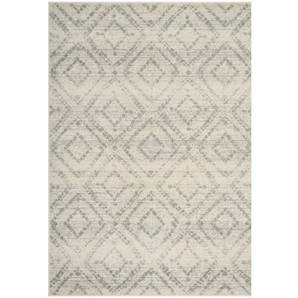 Buckleton Ivory/Light Blue Area Rug by Zipcode Design
