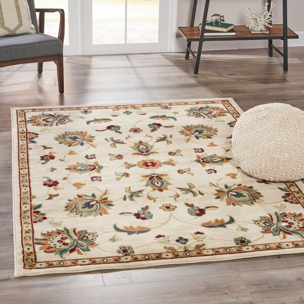 Patmos Vintage Floral Ivory Area Rug by Charlton Home