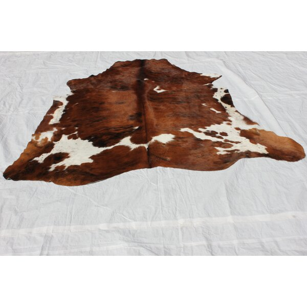 Upton Hand-Woven Cowhide Brown/Ivory Area Rug by Loon Peak