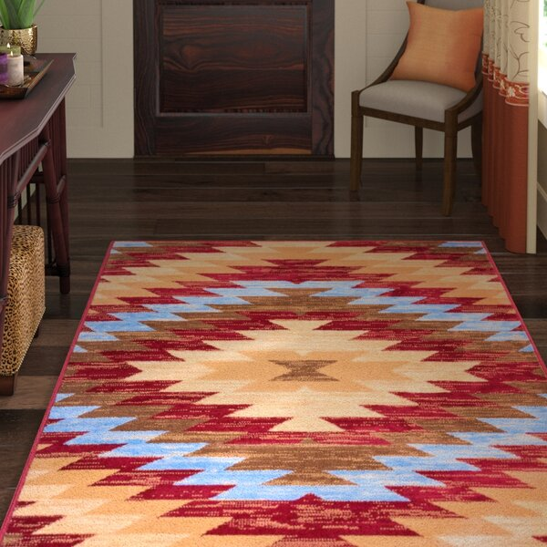 Binstead Southwestern Area Rug by World Menagerie