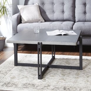 Best Choices Baran Distressed Coffee Table by Ivy Bronx