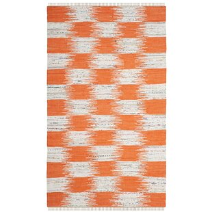 https://secure.img1-ag.wfcdn.com/im/70150781/resize-h310-w310%5Ecompr-r85/3809/38098705/opie-hand-knotted-cotton-orangegray-area-rug.jpg