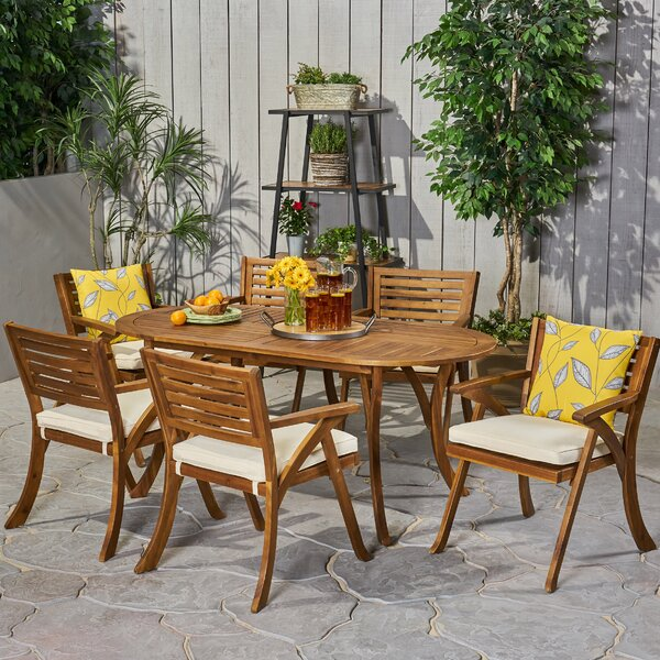 Jon Outdoor Oval 7 Piece Dining Set with Cushions by Rosecliff Heights
