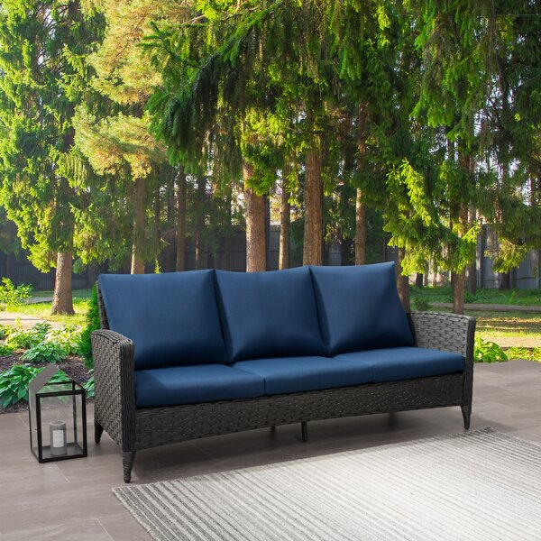 Rufina Wide Patio Sofa with Cushions by Highland Dunes