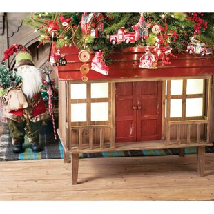 wood artificial tree stand by the holiday aisle