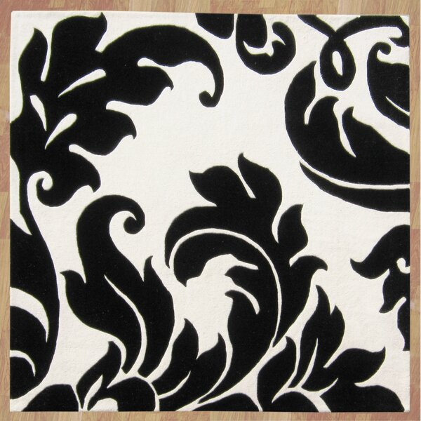 Noti Hand-Tufted Black & Ivory Area Rug by The Conestoga Trading Co.