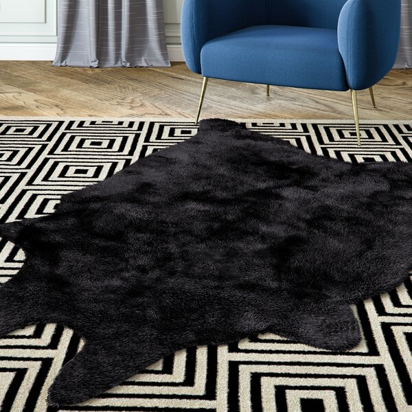 Sonnier Faux Sheepskin Black Area Rug by Willa Ar