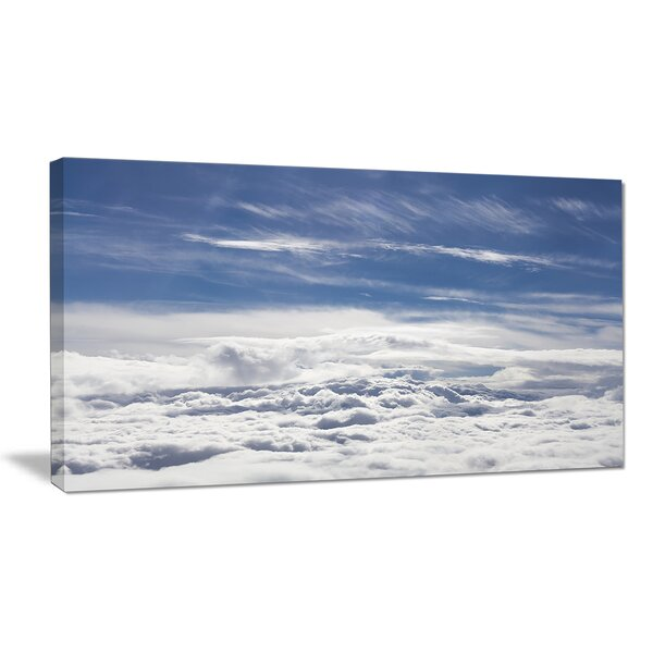 Flight over Bright Clouds Photographic Print on Wrapped Canvas by Design Art