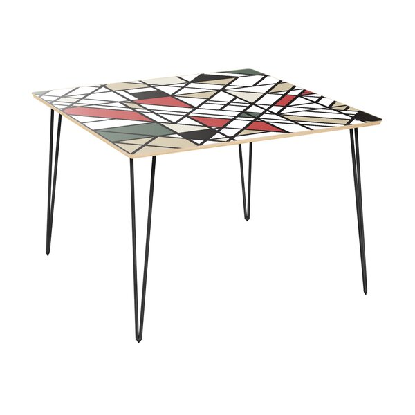 Conforti Dining Table by Wrought Studio