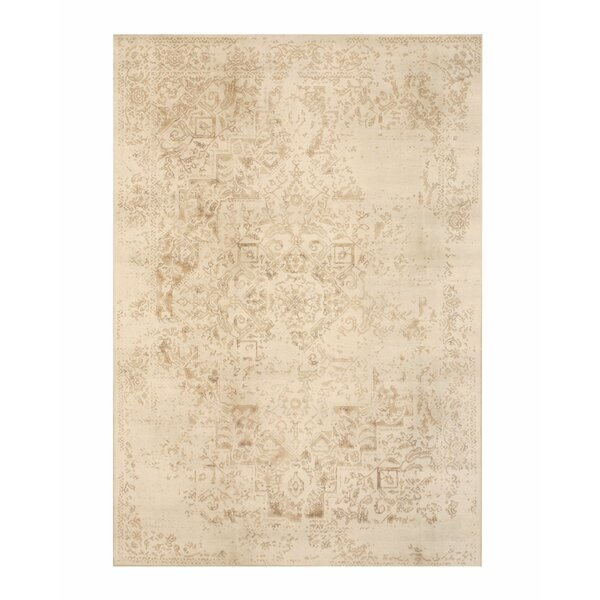 Phares Distressed Ivory Area Rug by Bungalow Rose