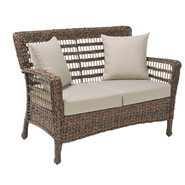 Dugas Faux Sea Patio Loveseat with Cushion by Bay Isle Home