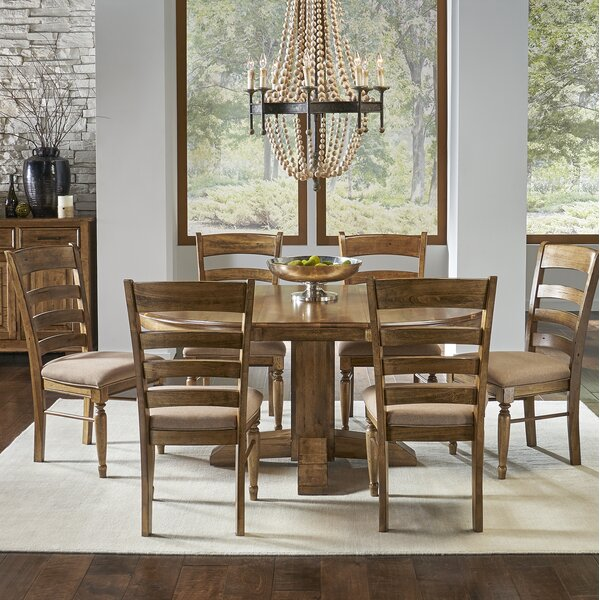 Ian 7 Piece Extendable Solid Wood Dining Set by One Allium Way