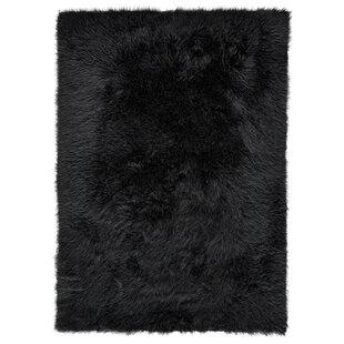 Buying Linden Faux Fur Black Area Rug ByHouse of Hampton