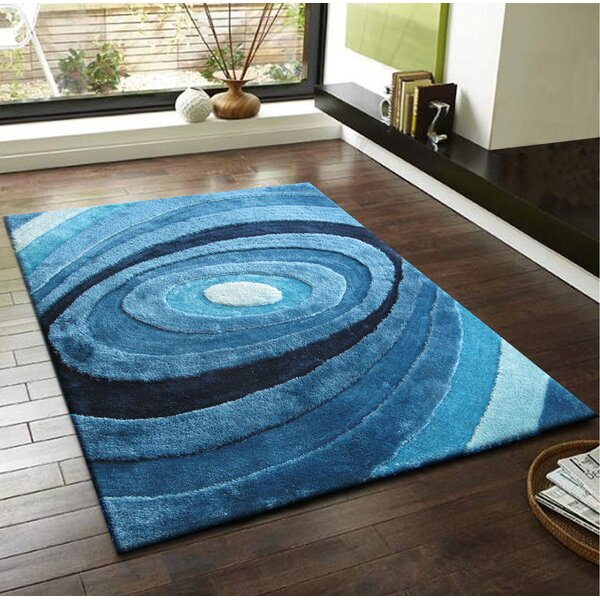 Qualls Hand-Tufted Turquoise Area Rug by Latitude Run