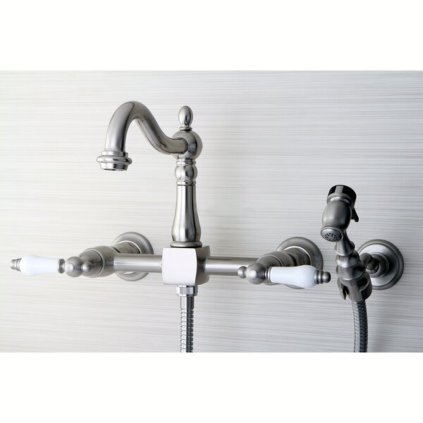 Heritage Double Handle Wall Mount Kitchen Faucet with Brass Sprayer by Kingston Brass