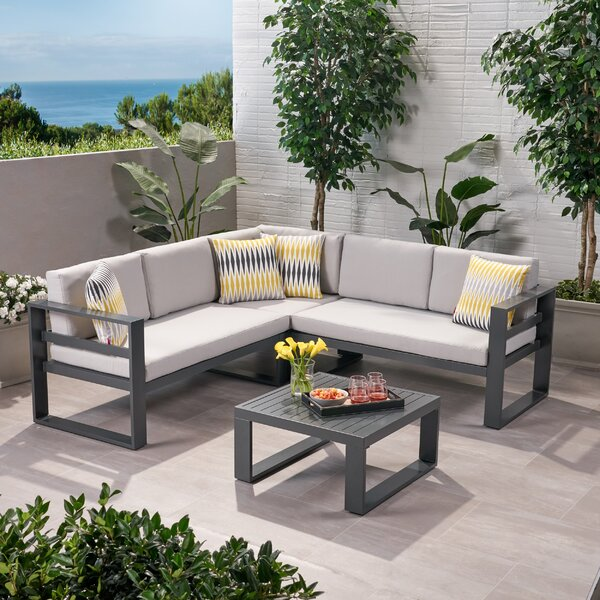 Caldicot Outdoor 4 Piece Sectional Seating Group with Cushions by Orren Ellis Orren Ellis