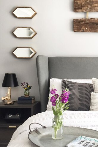 mirrors above nightstands magnificent grey linen headboard with petite identical mirrors hung above the nightstand fixes for blank space above your bed wayfair