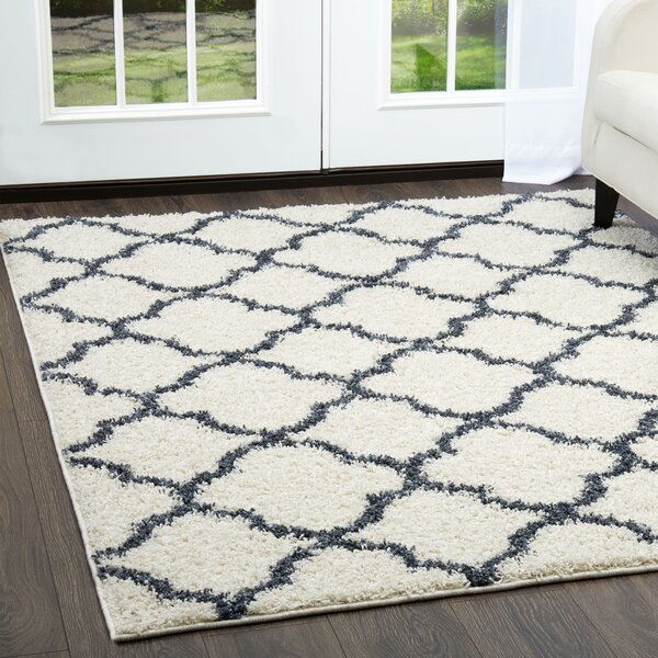 Synergy White/Blue Area Rug by Nicole Miller