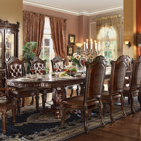 Welles Carved Extendable Dining Table by Astoria Grand